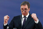 Serbia's President Aleksandar Vucic speaks during a press conference in Belgrade, Serbia, Sunday, March 17, 2019. Vucic has pledged to defend the country's law and order a day after opposition supporters stormed the national TV station protesting what they say is his autocratic rule. (AP Photo/Darko Vojinovic)