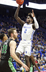 Kentucky's Kahlil Whitney (2) shoots near Utah Valley's Casdon Jardine (22) during the first half of an NCAA college basketball game in Lexington, Ky., Monday, Nov. 18, 2019. (AP Photo/James Crisp)