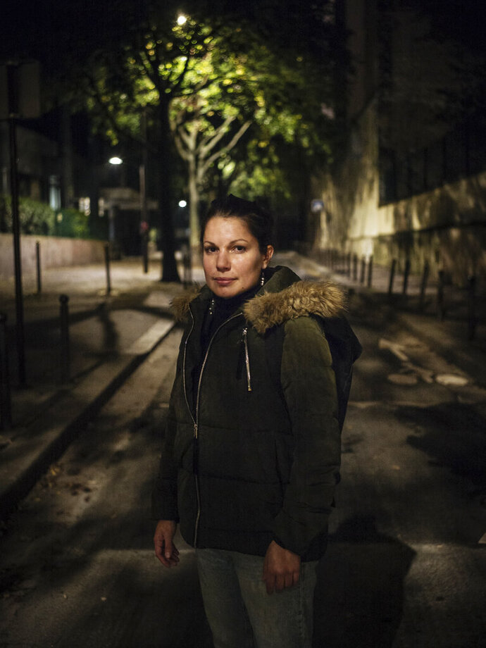 In this Oct. 31 2019 photo, Mathilde, 31, a jewelry student from Marseille, poses for a portrait in Paris. Mathilde experienced domestic violence when she was 21. Ten years later, she finally took back control of her life. Pasting is for her the way not to be a victim anymore and take back control of her fear. (AP Photo/Kamil Zihnioglu)
