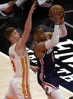 Washington Wizards' Russell Westbrook shoots past Atlanta Hawks' Kevin Huerter (3) during the first half of an NBA basketball game Monday, May 10, 2021, in Atlanta. (AP Photo/Ben Margot)