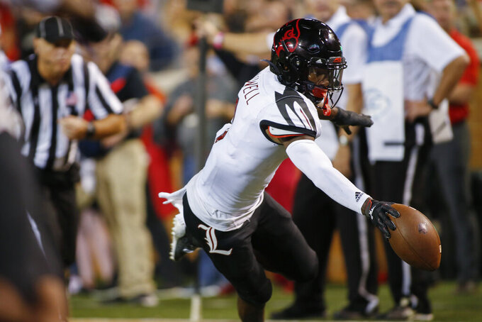 Louisville wide receiver Tutu Atwell reaches for the end zone as he scores on a 9-yard pass reception against Wake Forest during the first half of an NCAA college football game in Winston-Salem, N.C., Saturday, Oct. 12, 2019. (AP Photo/Nell Redmond)