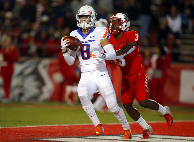 Boise State wide receiver Sean Modster (8) scores a touchdown as New Mexico cornerback D'Angelo Ross (3) defends during the first half of an NCAA college football game in Albuquerque, N.M., Friday, Nov. 16, 2018. (AP Photo/Andres Leighton)
