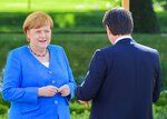 German Chancellor Angela Merkel and Italian Prime Minister Giuseppe Conte talk during a meeting in the garden of the German governmental guest house in Meseberg, outside Berlin, Monday, July 13, 2020. (Tobias Schwarz/Pool photo via AP)