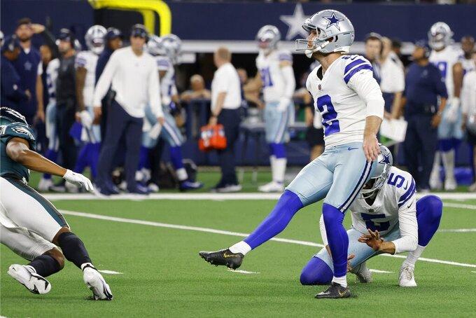Dallas Cowboys place kicker Greg Zuerlein (2) kicks an extra point int he first half of an NFL football game against the Philadelphia Eagles in Arlington, Texas, Monday, Sept. 27, 2021. (AP Photo/Michael Ainsworth)
