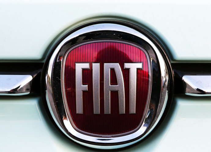 FILE - In this Oct. 31, 2019 file photo, a Fiat logo is pictured on a car in Bayonne, southwestern France. The United Auto Workers union has begun to focus bargaining on Fiat Chrysler, raising the possibility of another strike against a Detroit automaker. (AP Photo/Bob Edme, File)