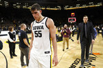 Iowa center Luka Garza walks off the court after the team's NCAA college basketball game against Purdue, Tuesday, March 3, 2020, in Iowa City, Iowa. Purdue won 77-68. (AP Photo/Charlie Neibergall)