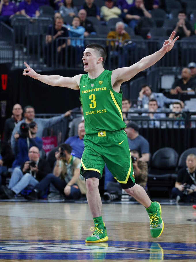 Oregon's Payton Pritchard celebrates after making a 3-point shot against Arizona State during the first half of an NCAA college basketball game in the semifinals of the Pac-12 men's tournament Friday, March 15, 2019, in Las Vegas. (AP Photo/John Locher)