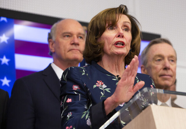 Speaker of the House Nancy Pelosi, D-Calif, center, speaks during a media conference after a meeting at NATO headquarters in Brussels, Monday, Feb. 17, 2020. Speaker of the House Nancy Pelosi is on a one day visit to Brussels to meet with leaders of the EU and NATO. (AP Photo/Virginia Mayo)