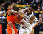 Oregon State guard Ethan Thompson, left, fights for control of a rebound with Colorado guard Tyler Bey in the second half of an NCAA college basketball game Thursday, Jan. 31, 2019, in Boulder, Colo. Oregon State won 76-74. (AP Photo/David Zalubowski)
