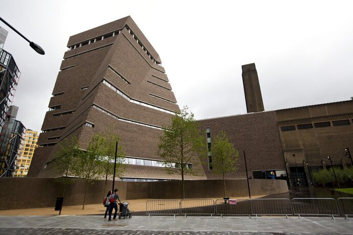 FILE - In this Tuesday, June 14, 2016 file photo, an exterior view shows a new building called the Switch House, at left, which has been added on to the Tate Modern gallery in London. London police have charged a man with criminal damage after an attack on a Picasso painting at the Tate Modern gallery. Police said charges were brought Tuesday, Dec. 31, 2019 against 20-year-old Shakeel Ryan Massey of northwest London for an attack that happened on Saturday. (AP Photo/Matt Dunham, file)