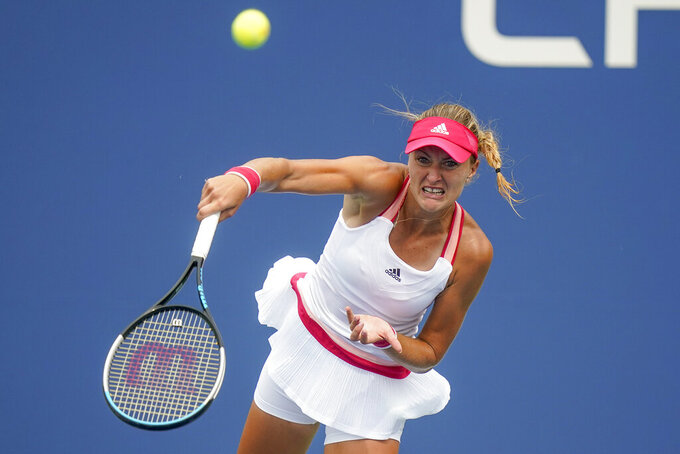 Kristina Mladenovic, of France, serves to Haley Baptiste, of the United States, during the first round of the US Open tennis championships, Monday, Aug. 31, 2020, in New York. (AP Photo/Frank Franklin II)