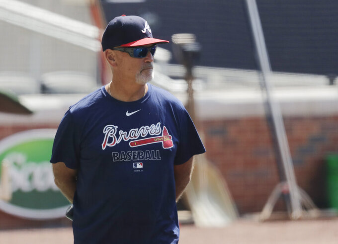 Atlanta Braves' manager Brian Snitker watches during team baseball practice at Truist Park on Friday, July 3, 2020, in Atlanta. (AP Photo/Brynn Anderson)