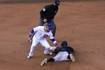 Miami Marlins' Jon Berti (5) steals second ahead of the attempted tag by Chicago Cubs second baseman Jason Kipnis as umpire Dan Iassogna (58) looks on in the eighth inning of Game 1 of a National League wild-card baseball series in Chicago, Wednesday, Sept. 30, 2020. (AP Photo/Nam Y. Huh)