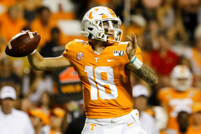 Tennessee quarterback Brian Maurer (18) goes to pass against Georgia at Neyland Stadium on Saturday, Oct. 5, 2019 in Knoxville, Tenn. Tennessee is changing quarterbacks, having freshman Brian Maurer make his first career start Saturday against No. 3 Georgia.  (C.B. Schmelter/Chattanooga Times Free Press via AP)