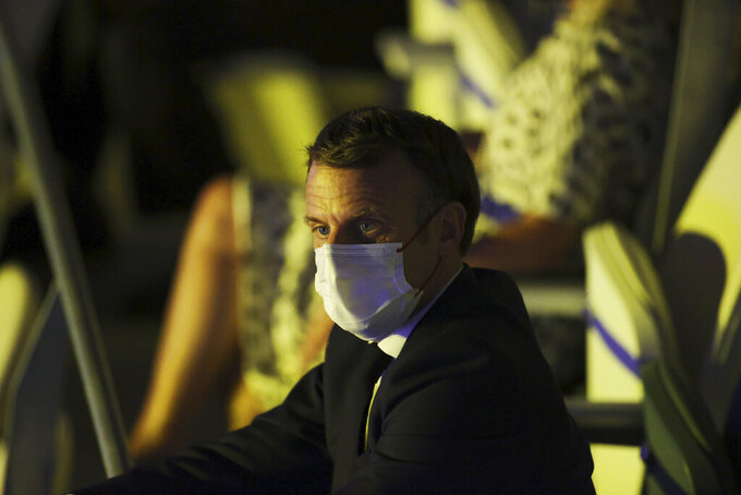 French President Emmanuel Macron watches the opening ceremony in the Olympic Stadium at the 2020 Summer Olympics, Friday, July 23, 2021, in Tokyo, Japan. (Leon Neal/Pool Photo via AP)