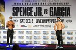 Boxers Errol Spence Jr., left, and Danny Garcia, right, pose after weigh-ins for their title match in Dallas, Friday, Dec. 4, 2020. Spence Jr. is putting his WBC and IBF welterweight titles on the line against Danny Garcia in his first fight since escaping serious injury in a high-speed car wreck in Dallas that led to misdemeanor drunken driving charges and could have derailed a promising career. The 30-year-old Spence is undefeated in 26 fights with 21 knockouts. Garcia, a 32-year-old from Philadelphia, is 36-2 and has 21 knockouts as well. (AP Photo/Tony Gutierrez)