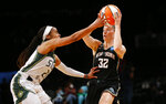 Seattle Storm guard Jordin Canada (21) defends against New York Liberty guard Sami Whitcomb (32) during the second half of a WNBA basketball game Wednesday, Aug. 18, 2021, in New York. (AP Photo/Noah K. Murray)