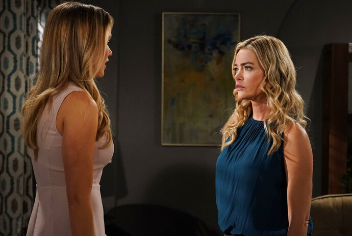 In this March 8, 2019 photo released by CBS, Katrina Bowden, left, and Denise Richards appear in a scene from the daytime series