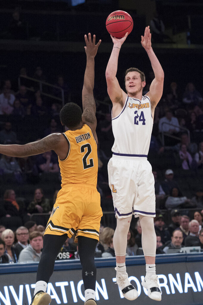 Lipscomb guard Garrison Mathews (24) shoots a 3-point goal past Wichita State guard Jamarius Burton (2) during the first half of a semifinal college basketball game in the National Invitational Tournament, Tuesday, April 2, 2019, at Madison Square Garden in New York. (AP Photo/Mary Altaffer)