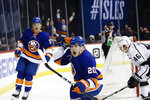 New York Islanders' Kieffer Bellows (20) celebrates after scoring his first NHL goal, as teammate Anthony Beauvillier, left, and Los Angeles Kings' Blake Lizotte, right, react during the second period of a hockey game Thursday, Feb. 6, 2020, in New York. (AP Photo/Frank Franklin II)