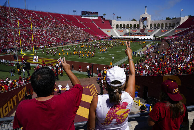 Southern California fans cheer as the band plays before an NCAA college football game against San Jose State Saturday, Sept. 4, 2021, in Los Angeles. (AP Photo/Ashley Landis)