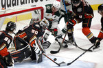 Anaheim Ducks goaltender Ryan Miller (30) eyes the puck as Minnesota Wild left wing Zach Parise (11) and Ducks defenseman Cam Fowler (4) look for a rebound during the first period of an NHL hockey game in Anaheim, Calif., Wednesday, Jan. 20, 2021. (AP Photo/Alex Gallardo)