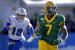 Baylor running back John Lovett (7) is chased by Kansas linebacker Gavin Potter (19) as he runs for a first down during the first half of an NCAA college football game Saturday, Nov. 30, 2019, in Lawrence, Kan. (AP Photo/Charlie Riedel)