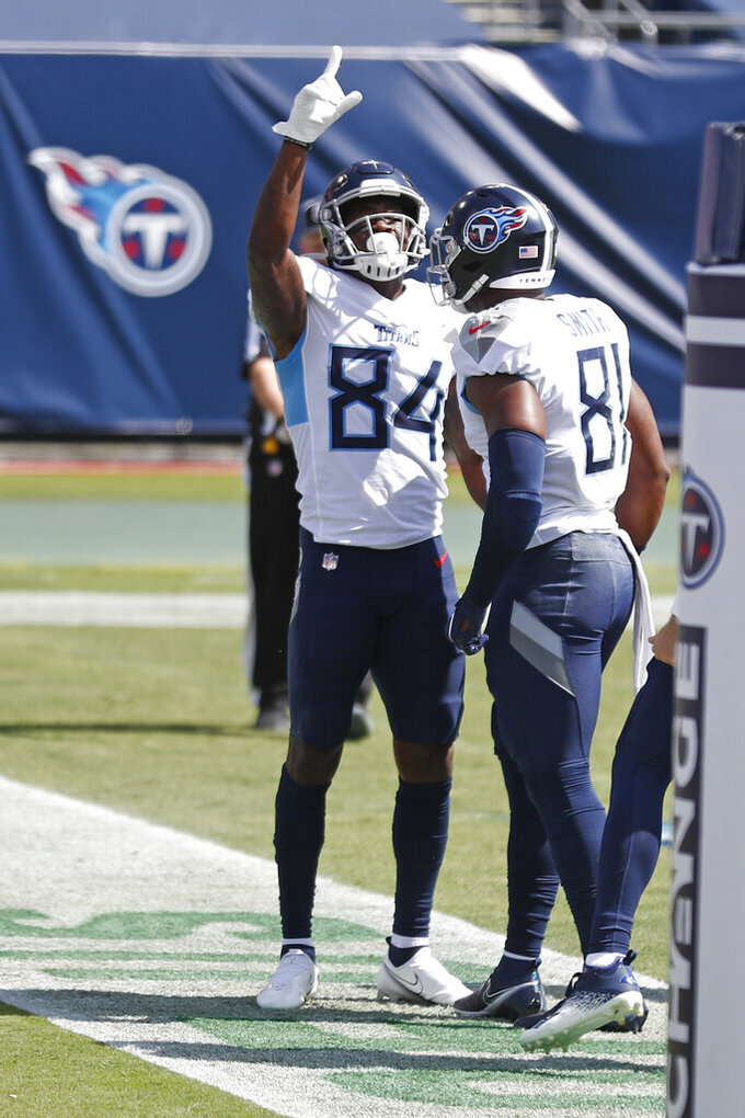 Tennessee Titans wide receiver Corey Davis (84) celebrates a touchdown pass reception with tight end Jonnu Smith (81) in the first half of an NFL football game against the Jacksonville Jaguars Sunday, Sept. 20, 2020, in Nashville, Tenn. (AP Photo/Wade Payne)