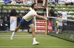 Gilles Simon returns the ball to Feliciano Lopez during their match at the ATP Mercedes Cup tournament in Stuttgart, Thursday, June 14, 2018 in Aktion. (Marijan Murat/dpa via AP)