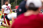 Washington Football Team offensive tackle Sam Cosmi (76) warms up at the team's NFL football training camp practice in Ashburn, Va., Tuesday, Aug. 3, 2021. (AP Photo/Andrew Harnik)