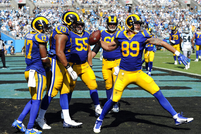 Los Angeles Rams tight end Tyler Higbee (89) spikes the football following his touchdown against the Carolina Panthers during the second half of an NFL football game in Charlotte, N.C., Sunday, Sept. 8, 2019. (AP Photo/Mike McCarn)