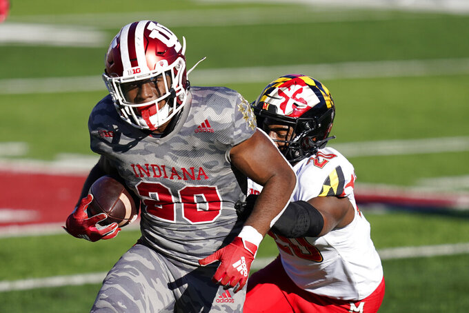 Indiana's Tim Baldwin Jr. (20) runs past Maryland's Antwaine Richardson (20) during the second half of an NCAA college football game, Saturday, Nov. 28, 2020, in Bloomington, Ind. Indiana won 27-11. (AP Photo/Darron Cummings)