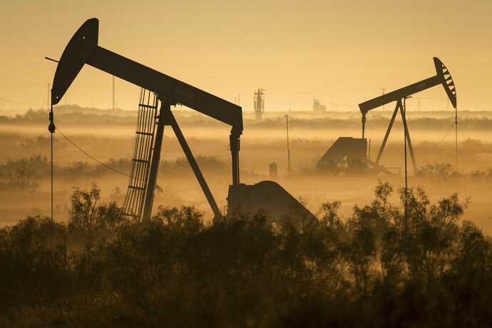 Fog blankets a low-lying area where pumpjacks operate in West Texas, northeast of Kermit, on Sept. 12, 2018. In December 2017, companies in the Permian Basin _ an ancient, oil-rich seabed that spans West Texas and southeastern New Mexico _ produced twice as much oil as they had four years earlier, during the last boom. Forecasters expect production to double again by 2023. (Jerod Foster/The Texas Tribune via AP)