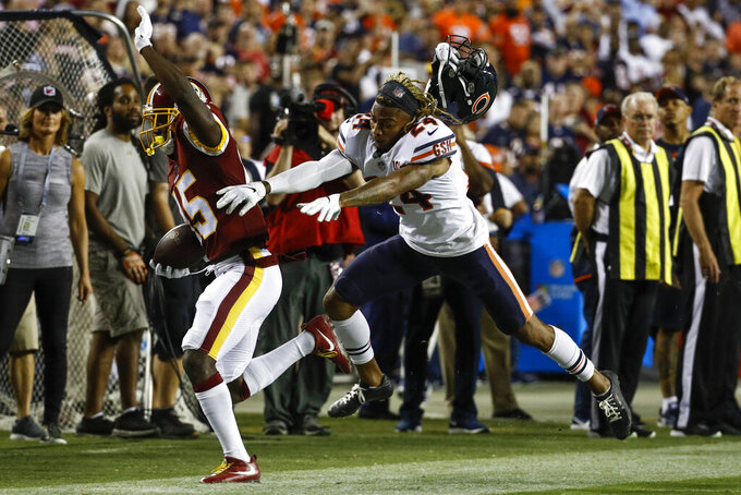 Washington Redskins wide receiver Steven Sims (15) is forced out of bounds after stiff-arming the helmet off Chicago Bears cornerback Buster Skrine (24) during the second half of an NFL football game Monday, Sept. 23, 2019, in Landover, Md. (AP Photo/Patrick Semansky)