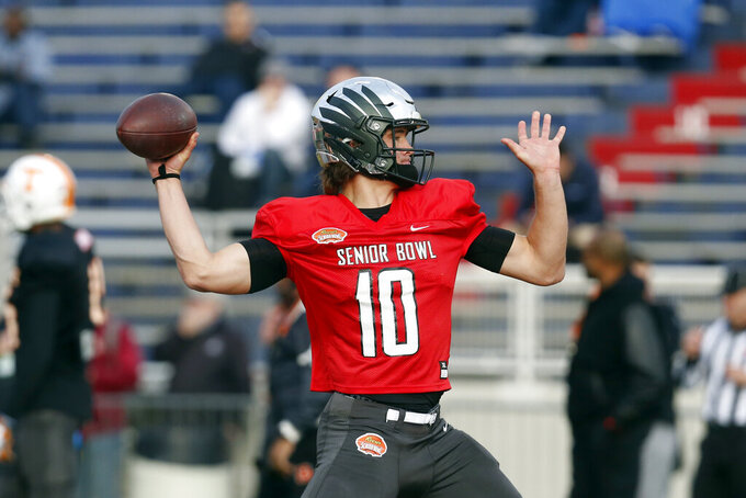 Oregon's Justin Herbert of the South squad runs drills during practice for the Senior Bowl college football game, Wednesday, Jan. 22, 2020, in Mobile, Ala. (AP Photo/Butch Dill)