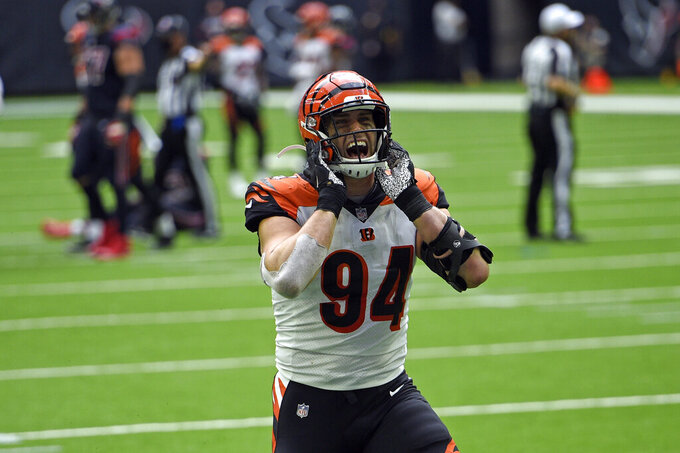 Cincinnati Bengals defensive end Sam Hubbard (94) celebrates after forcing a fumble by Houston Texans quarterback Deshaun Watson during the second half of an NFL football game Sunday, Dec. 27, 2020, in Houston. The Bengals recovered the fumble and beat the Texans 37-31. (AP Photo/Eric Christian Smith)