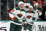 Minnesota Wild center Eric Staal (12) and Matt Dumba, rear, celebrate after Staal scored in the first period of an NHL hockey game against the Dallas Stars in Dallas, Tuesday, Oct. 29, 2019. (AP Photo/Tony Gutierrez)