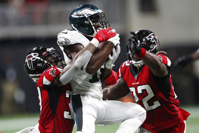 Atlanta Falcons free safety Ricardo Allen (37) and Atlanta Falcons strong safety Keanu Neal (22) make the hit on Philadelphia Eagles wide receiver Nelson Agholor (13) during the second half of an NFL football game, Sunday, Sept. 15, 2019, in Atlanta. The Atlanta Falcons won 24-20. (AP Photo/John Bazemore)