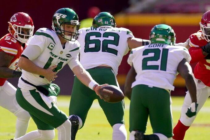 New York Jets quarterback Sam Darnold (14) prepares to hand the ball off to running back Frank Gore (21) in the first half of an NFL football game against the Kansas City Chiefs on Sunday, Nov. 1, 2020, in Kansas City, Mo. (AP Photo/Charlie Riedel)