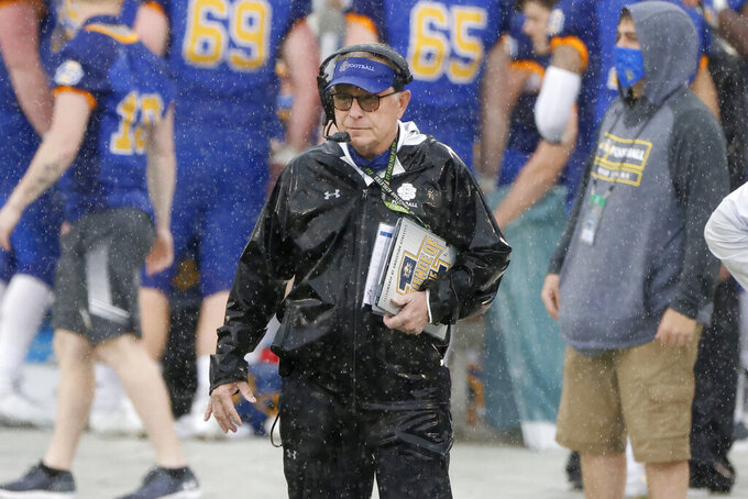 South Dakota State head coach John Stiegelmeier watches his team play against Sam Houston State during the first half of the NCAA college FCS Football Championship in Frisco, Texas, Sunday May 16, 2021. (AP Photo/Michael Ainsworth)