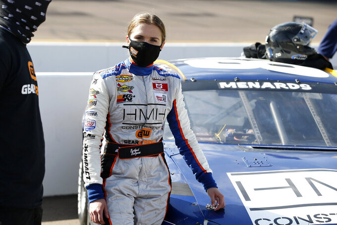 Bridget Burgess stands with her race car prior to the ARCA Series auto race at Phoenix Raceway, Saturday, Nov. 7, 2020, in Avondale, Ariz. (AP Photo/Ralph Freso)