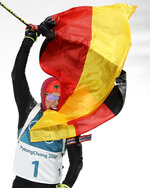 Laura Dahlmeier, of Germany, waves the German flag in the finish area after winning the gold medal in the women's 10-kilometer biathlon pursuit at the 2018 Winter Olympics in Pyeongchang, South Korea, Monday, Feb. 12, 2018. (AP Photo/Gregorio Borgia)