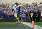 UCLA running back Joshua Kelley (27) scores a rushing touchdown against Southern California during the second half of an NCAA college football game Saturday, Nov. 17, 2018, in Pasadena, Calif. (AP Photo/Marcio Jose Sanchez)