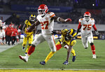 FILE - In this Nov. 19, 2018, file photo, Kansas City Chiefs running back Kareem Hunt (27) scores a touchdown ahead of Los Angeles Rams free safety Lamarcus Joyner (20) as Chiefs offensive guard Cameron Erving (75) looks on during the first half of an NFL football game, in Los Angeles. The Cleveland Browns have signed Kareem Hunt, the running back cut by Kansas City in November after a video showed him pushing and kicking a woman the previous February.  Cleveland general manager John Dorsey, who drafted Hunt while working for Kansas City, on Monday, Feb. 11, 2019,  said the Browns