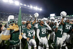 Michigan State players celebrate following an NCAA college football game against Western Kentucky, Saturday, Oct. 2, 2021, in East Lansing, Mich. Michigan State won 48-31. (AP Photo/Al Goldis)