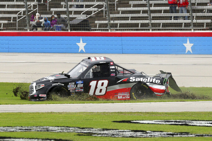 NASCAR Texas Trucks Series driver Christian Eckes (18) slides onto the infield grass after contact from another vehicle during an auto race at Texas Motor Speedway in Fort Worth, Texas, Sunday, Oct. 25, 2020. (AP Photo/Richard W. Rodriguez)
