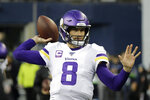 Minnesota Vikings quarterback Kirk Cousins warms up before an NFL football game against the Seattle Seahawks, Monday, Dec. 2, 2019, in Seattle. (AP Photo/Ted S. Warren)
