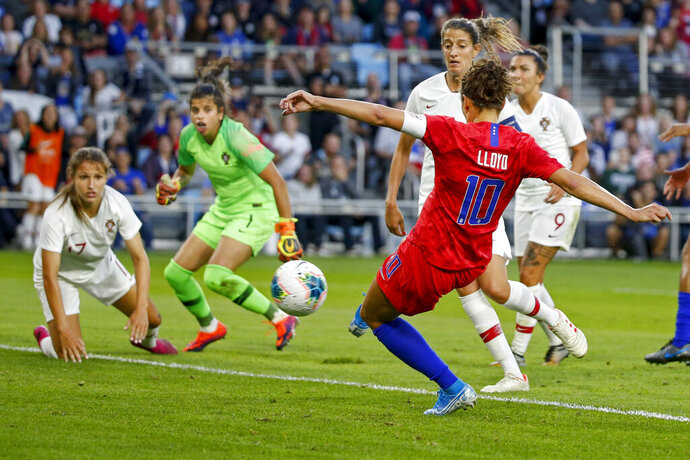 United States' Carli Lloyd scores a goal against Portugal during the first half of a friendly soccer match Tuesday, Sept. 3, 2019, in St. Paul, Minn. (AP Photo/Bruce Kluckhohn)