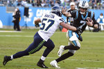 Seattle Seahawks linebacker Cody Barton (57) chases Carolina Panthers quarterback Kyle Allen (7) during the second half of an NFL football game in Charlotte, N.C., Sunday, Dec. 15, 2019. (AP Photo/Mike McCarn)