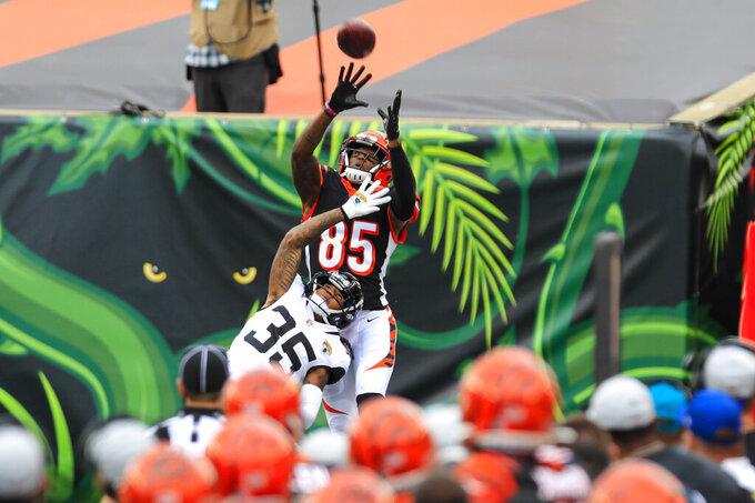 Jacksonville Jaguars running back Devine Ozigbo (35) breaks up a pass intended for Cincinnati Bengals wide receiver Tee Higgins (85) in the first half of an NFL football game in Cincinnati, Sunday, Oct. 4, 2020. (AP Photo/Aaron Doster)